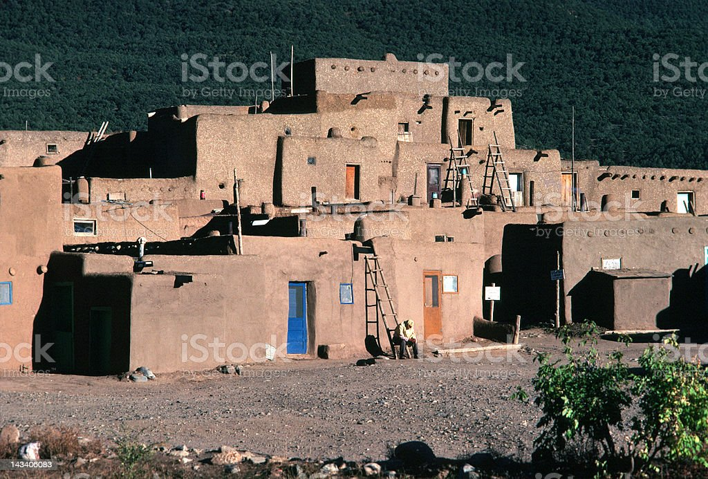 Taos Pueblo Dwelling with Ladders stock photo