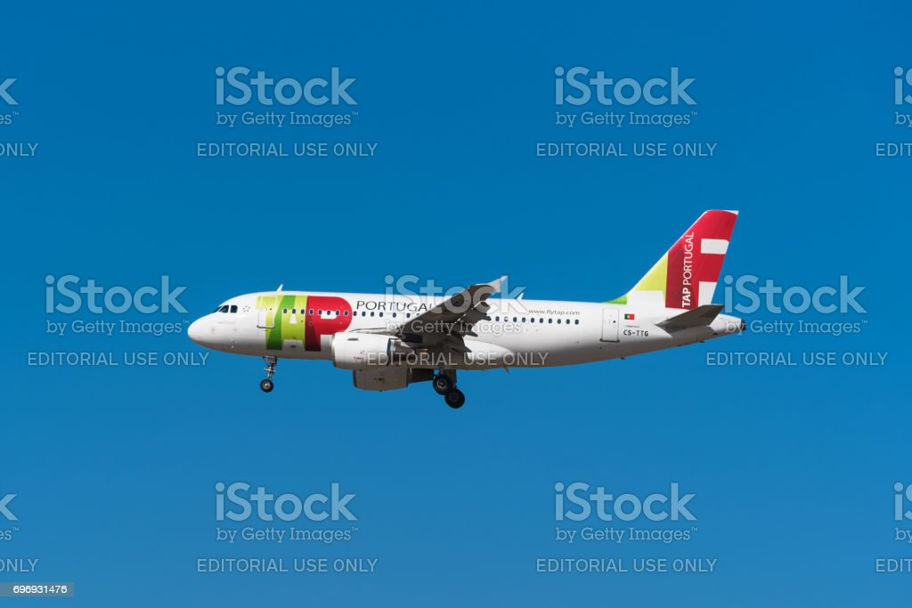 Tap Portugal Airbus 319 is landing in Madrid Barajas airport. stock photo