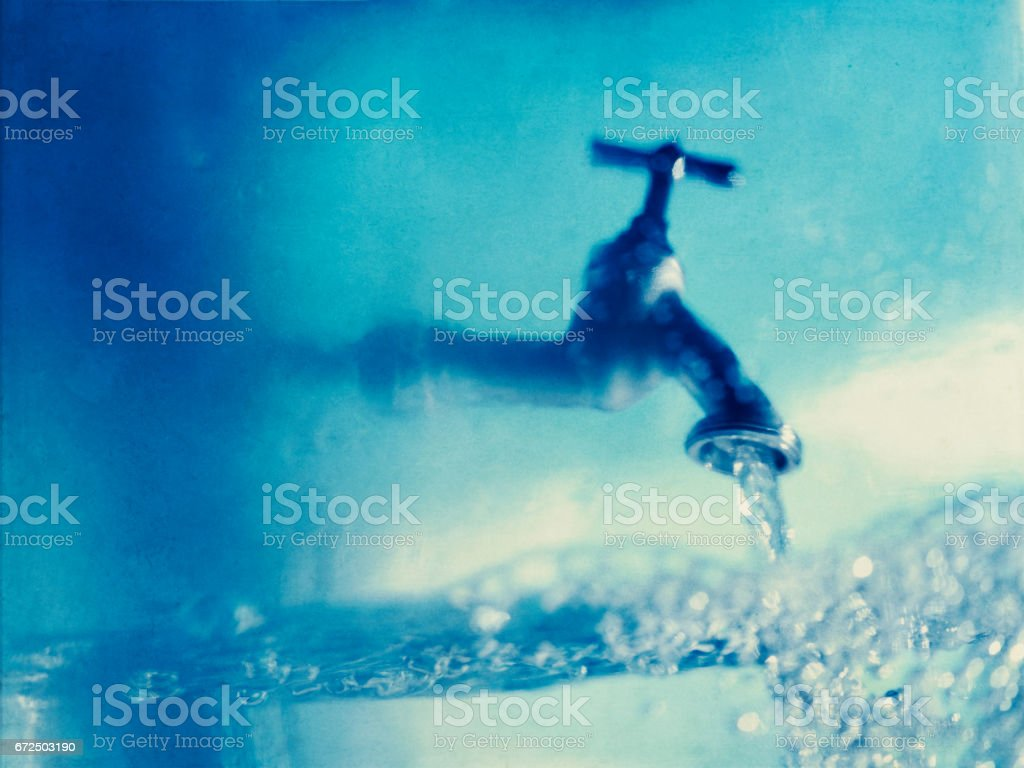Tap water blue bubbles stock photo