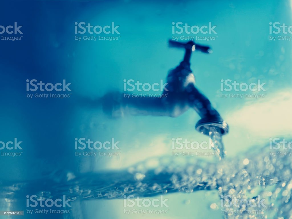 Tap water blue stock photo