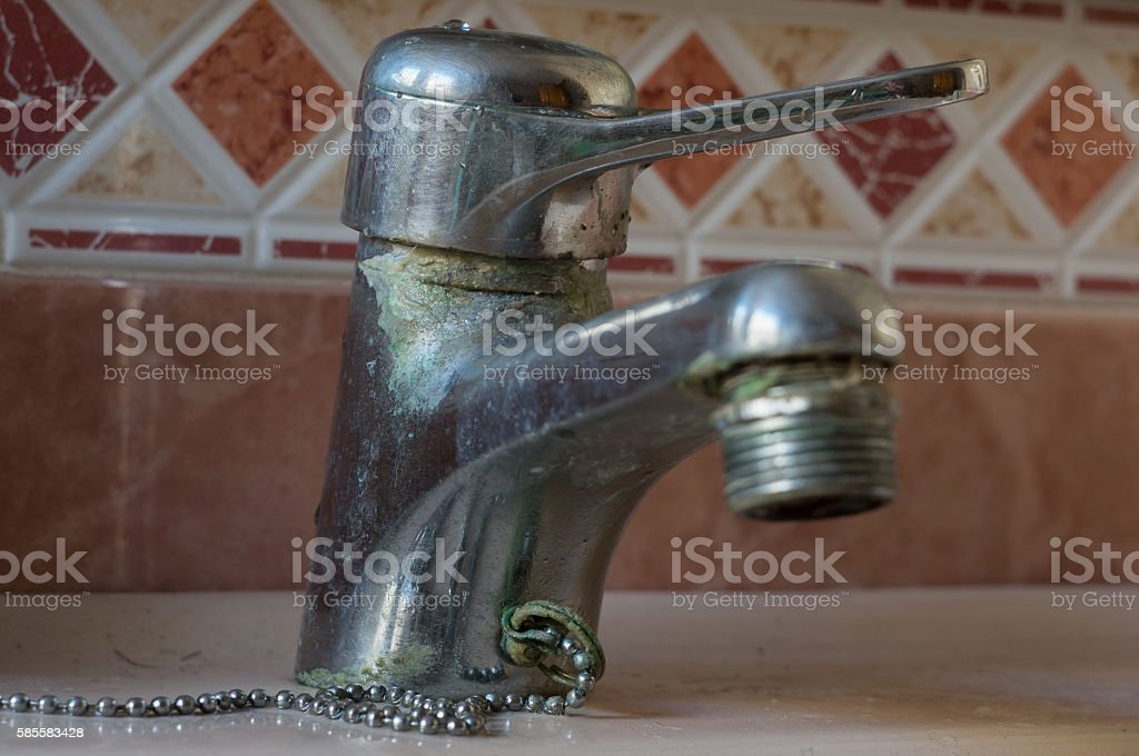 Tap water with lime scales stock photo