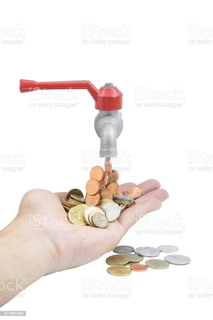 tap with money falling on a white background stock photo