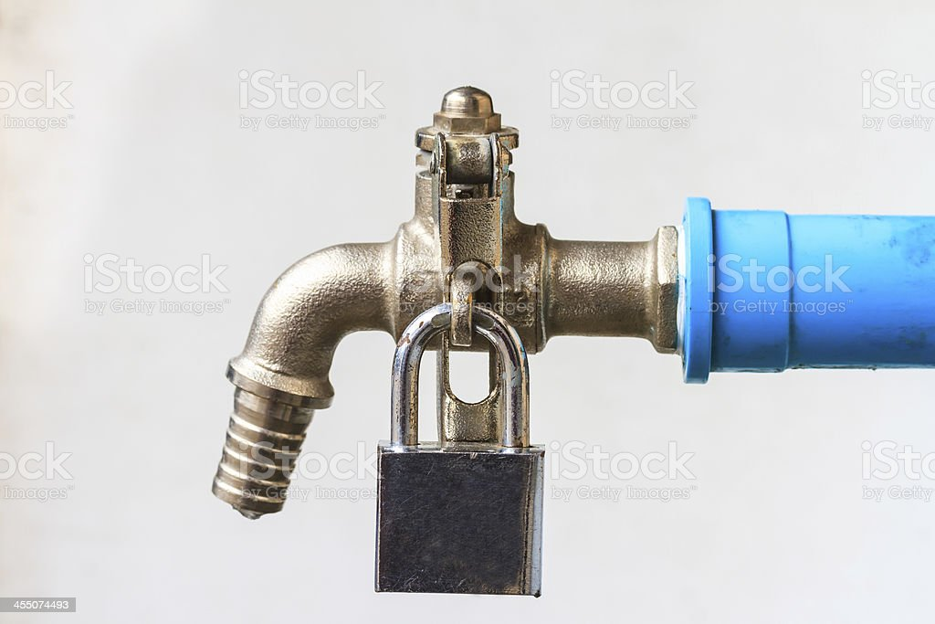 Tap with padlock royalty-free stock photo