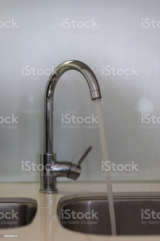 Tap with running water stock photo