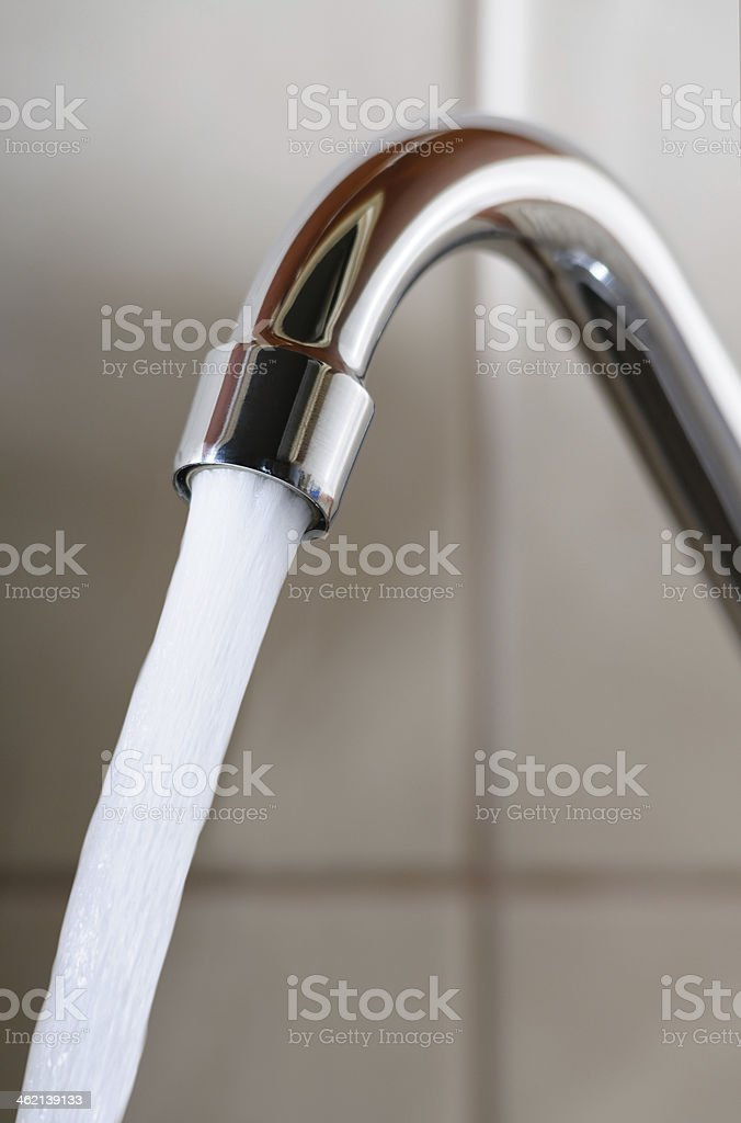 Tap with Water Flowing Strongly stock photo