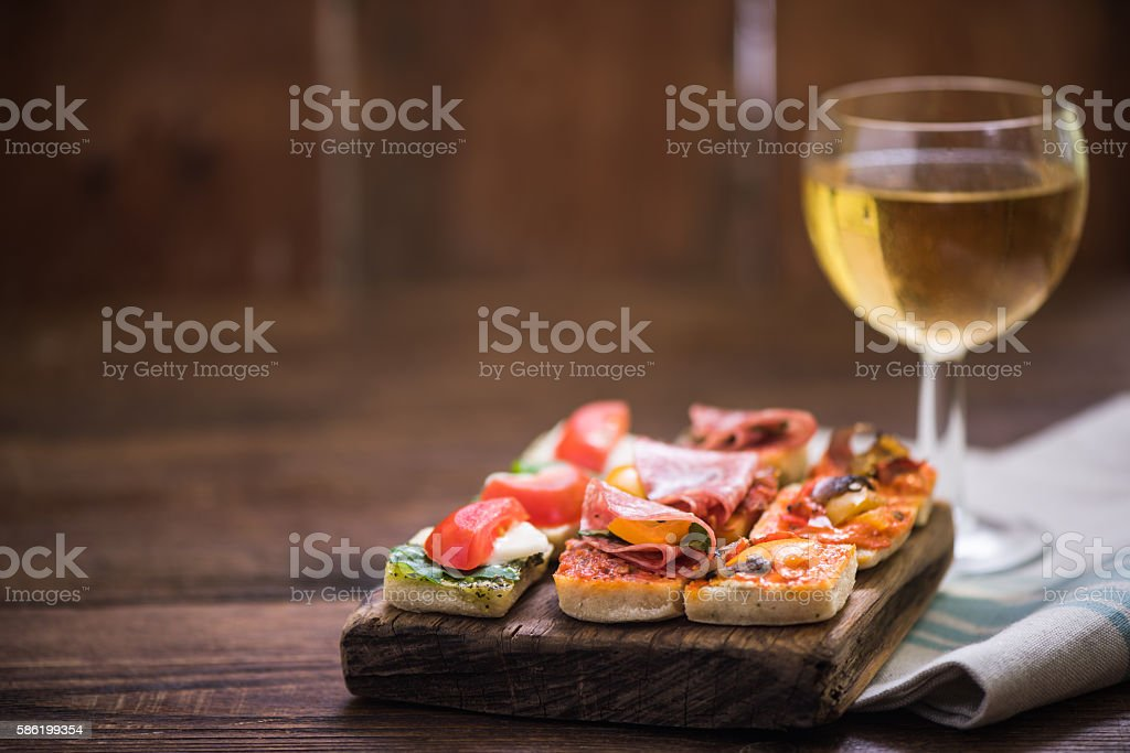 tapas and wine served on wooden board stock photo