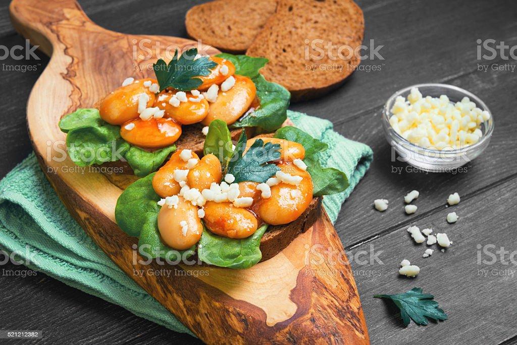 tapas sandwiches with giant white beans stock photo
