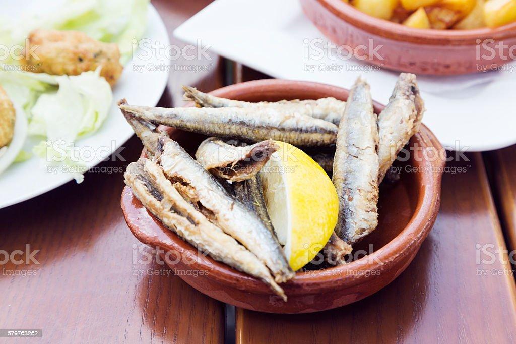 Tapas series: deep-fried sardines stock photo