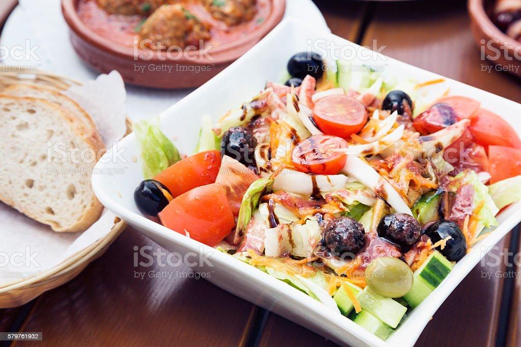 Tapas series: tomato salad with onions stock photo