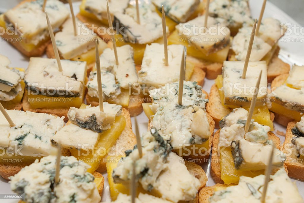 tapas starters sandwiches with blue cheese and pine slice stock photo