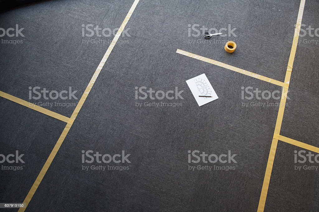 Tape lines on office floor for furniture placement stock photo
