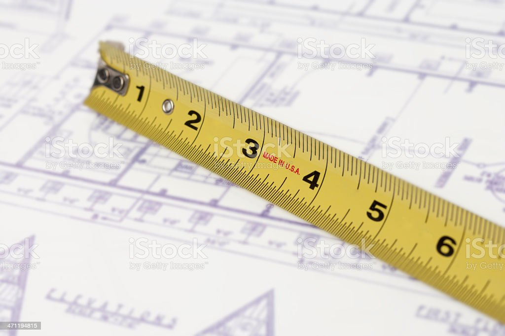 Tape measure and blueprint (XXL) royalty-free stock photo