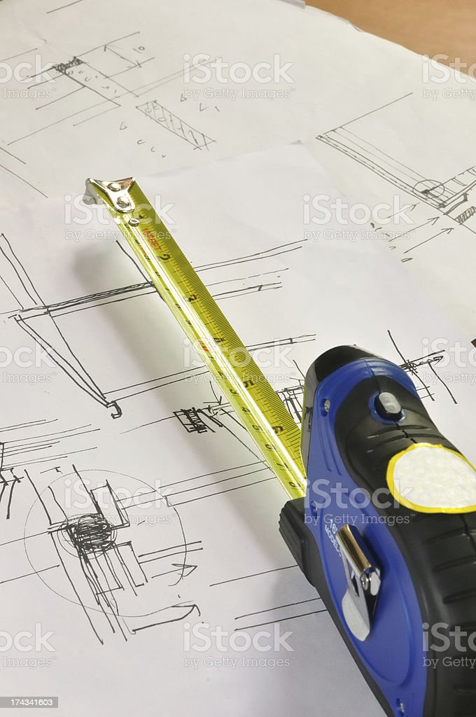 tape measure and construction plan royalty-free stock photo