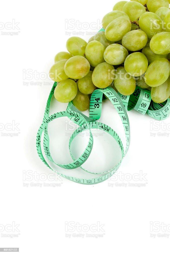 Tape Measure Around Grape royalty-free stock photo