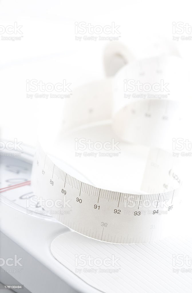 Tape Measure in Centimeters on a White Scale royalty-free stock photo