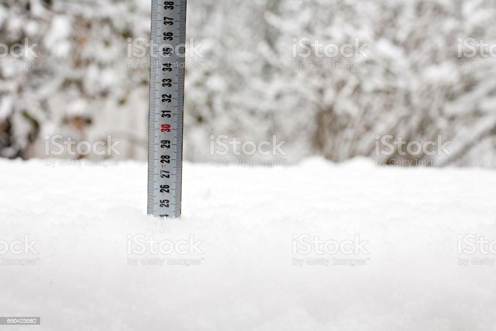 tape measure in snow stock photo