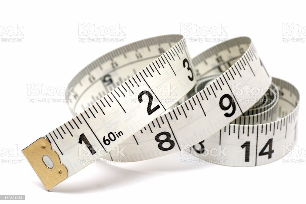 Tape measure measuring inches in white background royalty-free stock photo