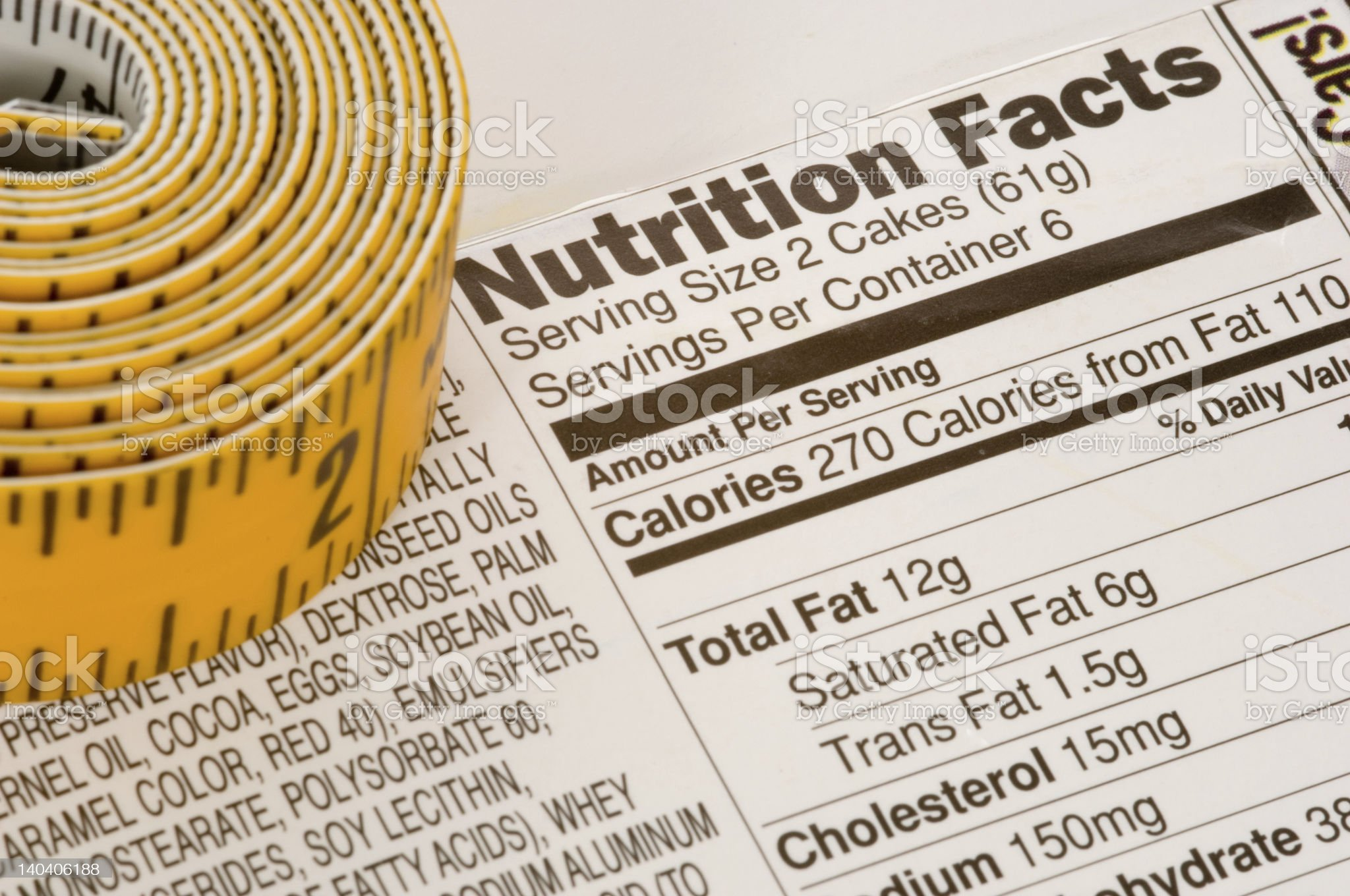 A tape measure next to nutrition facts royalty-free stock photo