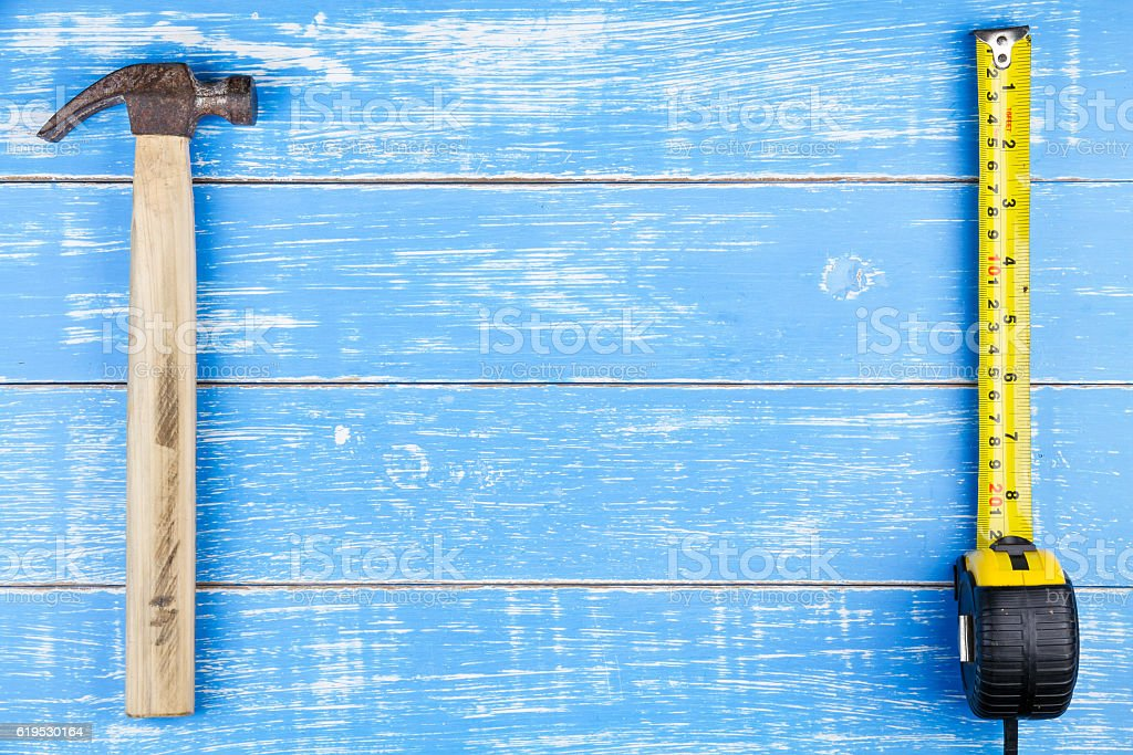Tape measure on blue wooden table background copy space. stock photo