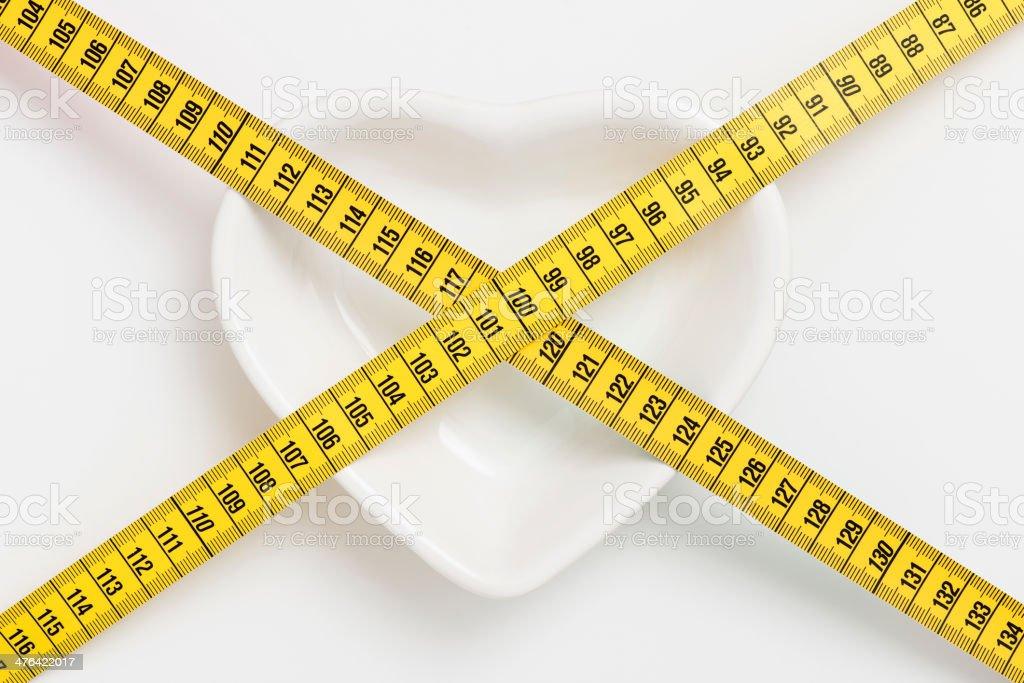 tape measure on heart shape plate royalty-free stock photo