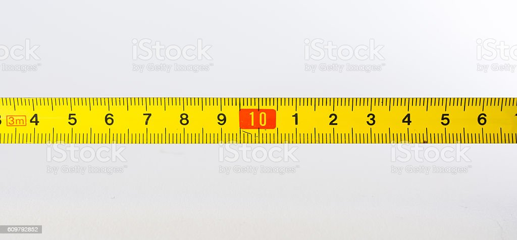 Tape Measure Rolled Out Yellow Bright Lines Closeup Construction stock photo