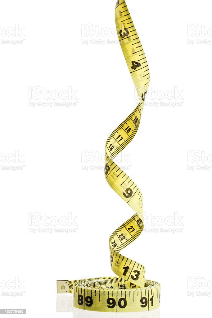 Tape Measure spirals upwards stock photo
