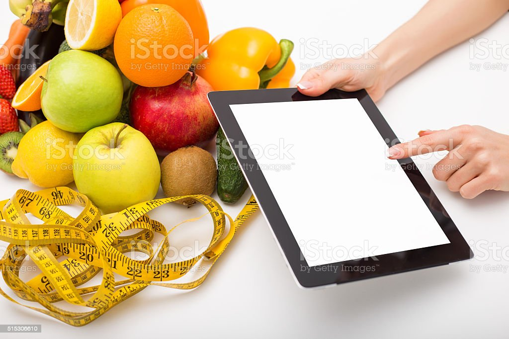 Tape measure, vegetables, and tablet with blank screen stock photo
