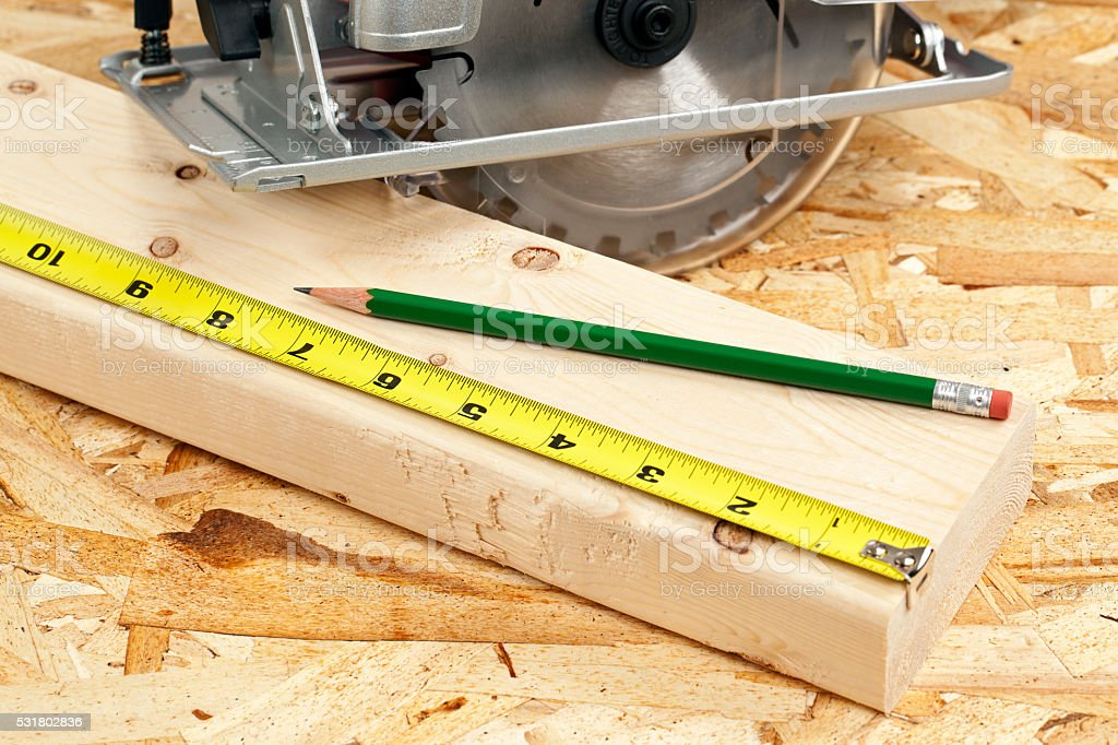 Tape Measure Wood and a Circular Saw stock photo