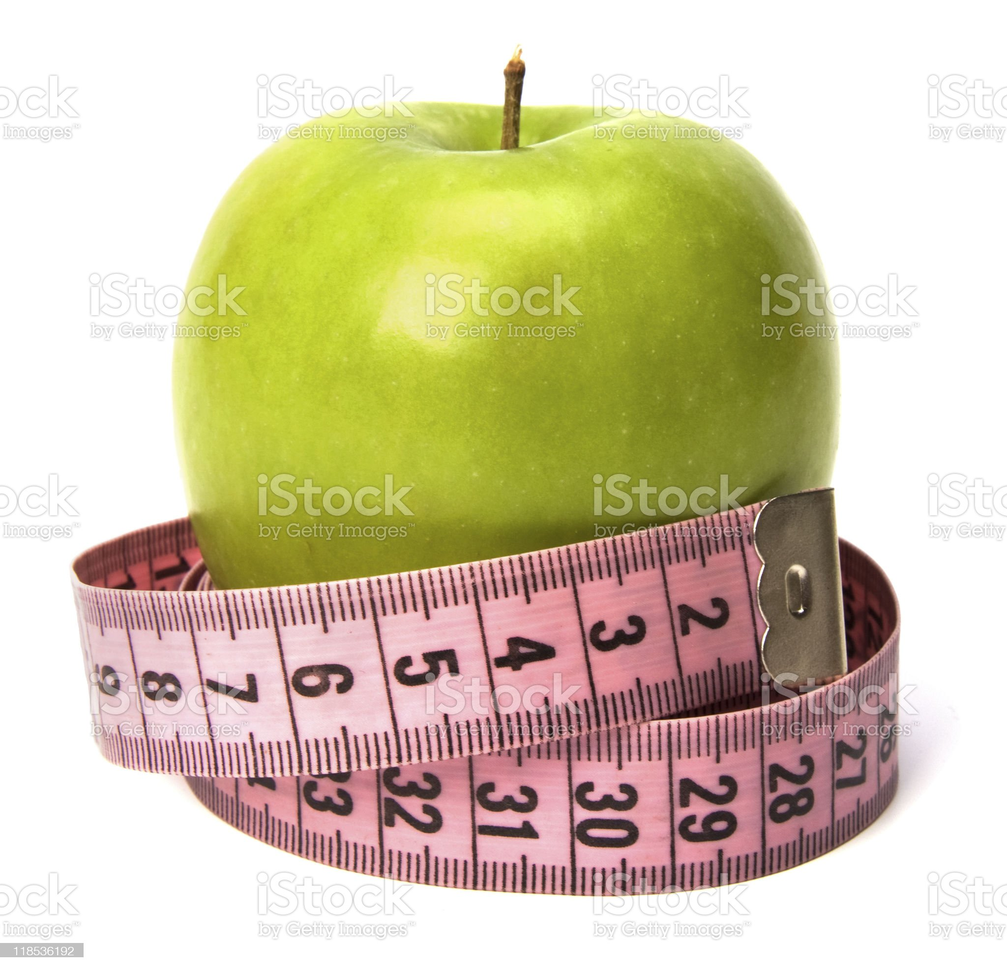 tape measure wrapped around the green apple royalty-free stock photo