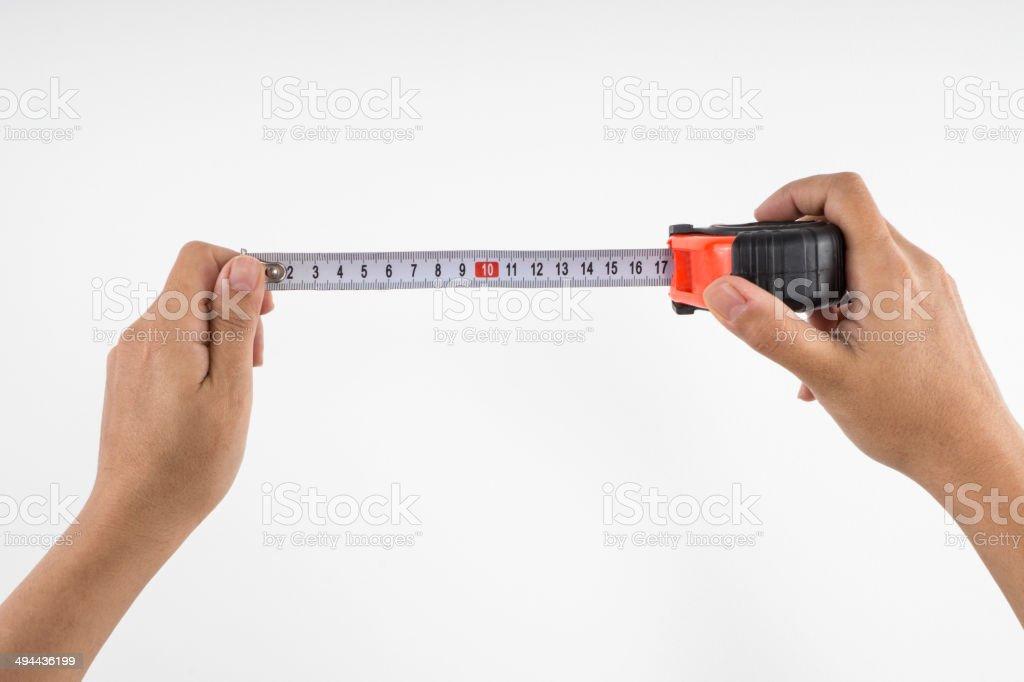 Tape Measurer in Hand stock photo