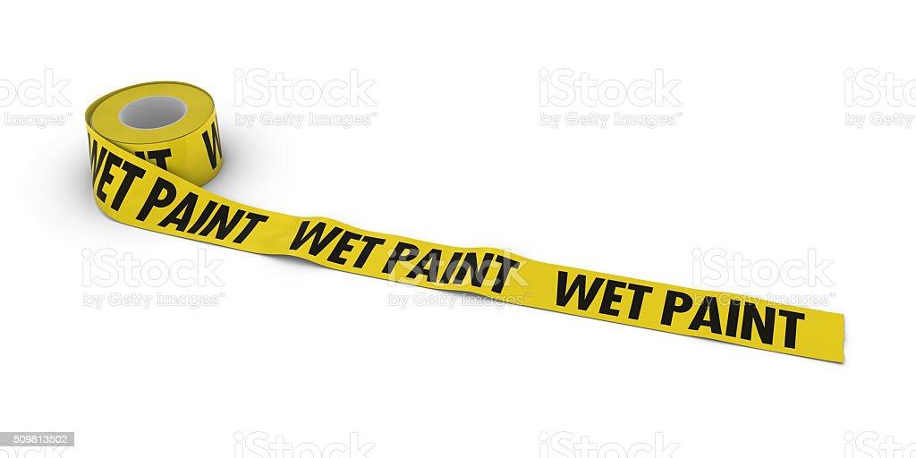 WET PAINT Tape Roll unrolled across white floor stock photo