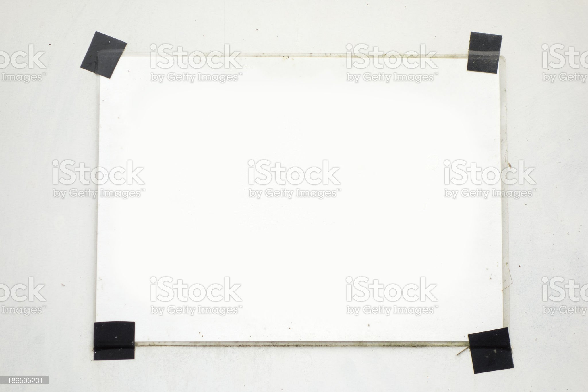 Taped blanc white a4 paper on the wall royalty-free stock photo