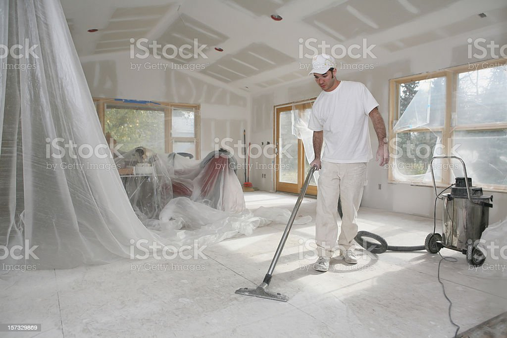 Taper Vacuuming Dust stock photo