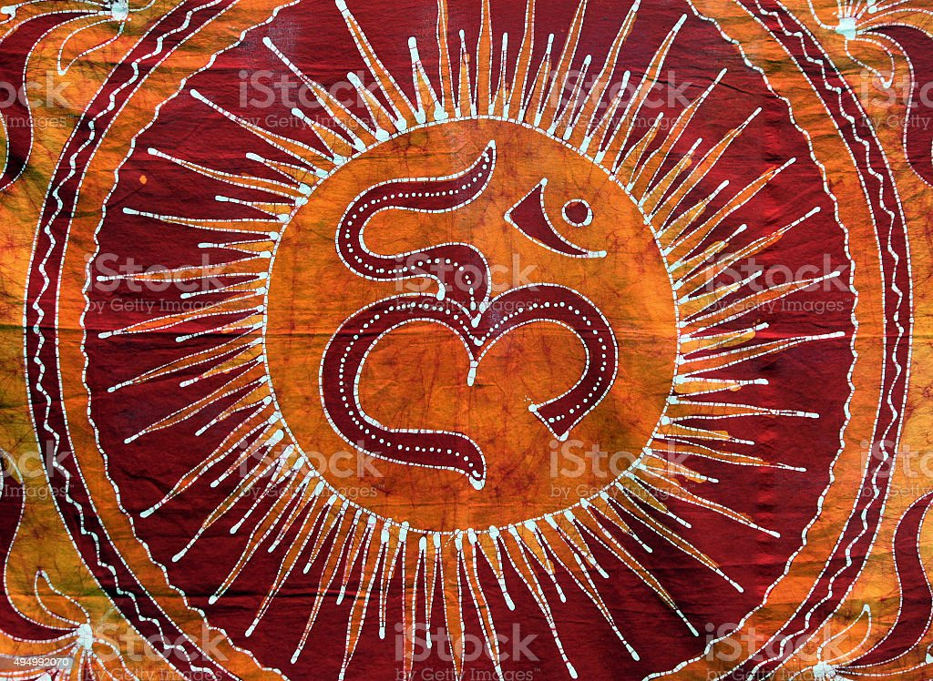 Tapestry for Sale at a Street Market with 'Om' Symbol stock photo