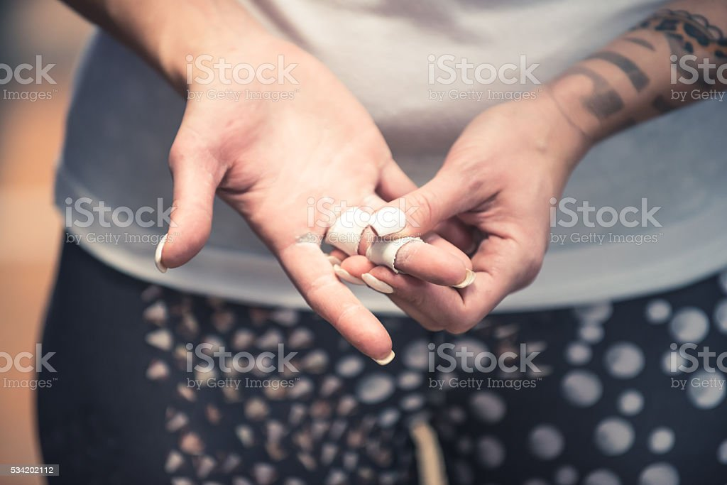 Taping hands before workout stock photo