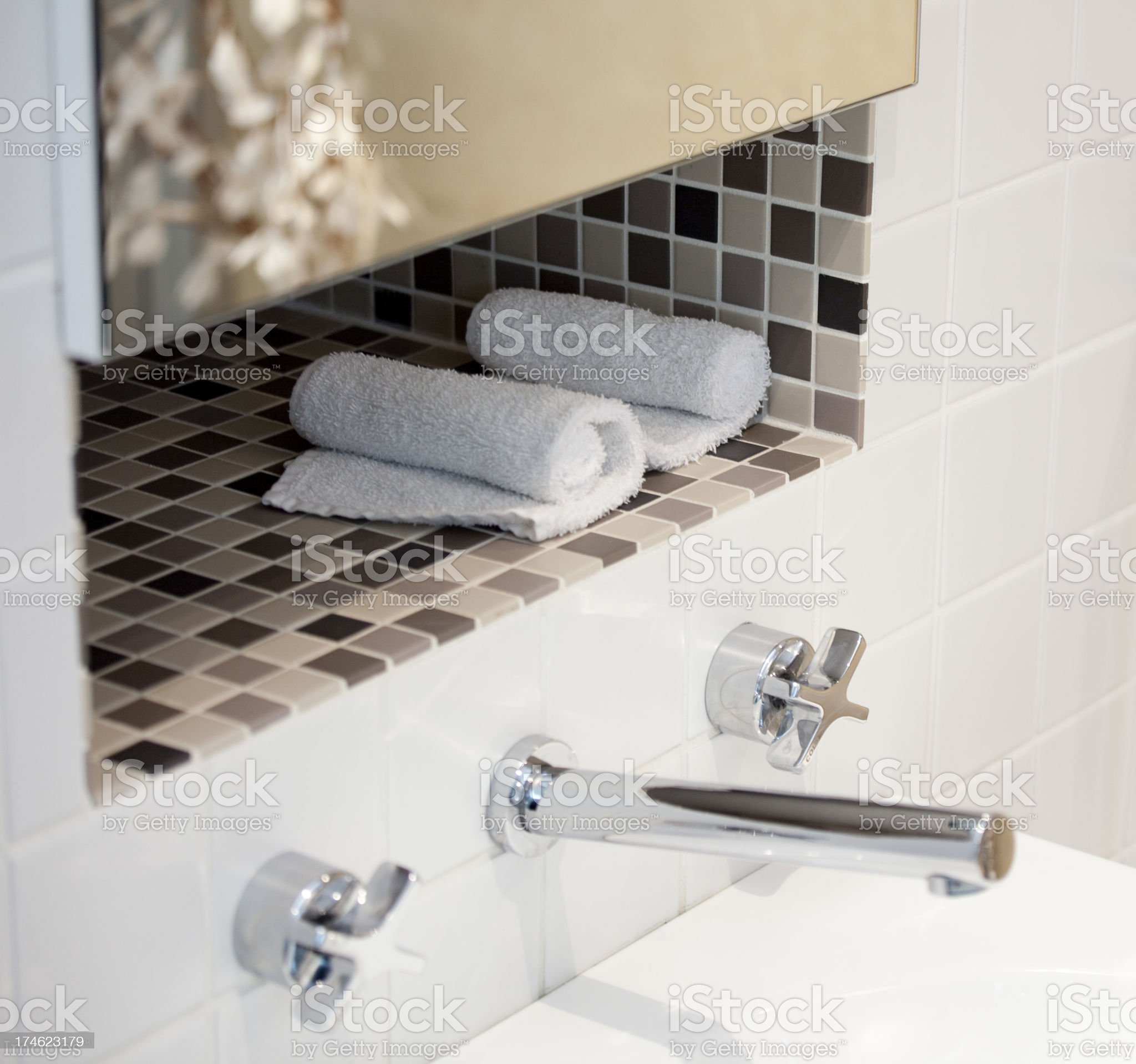 Taps and towels royalty-free stock photo