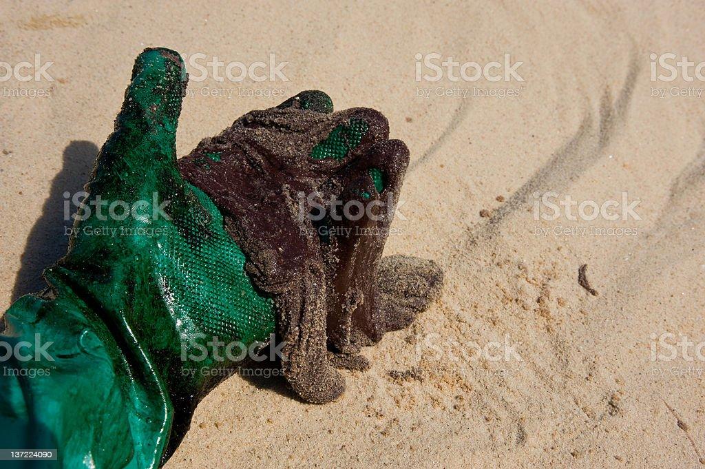 Tar Ball on the beach from oil spill stock photo