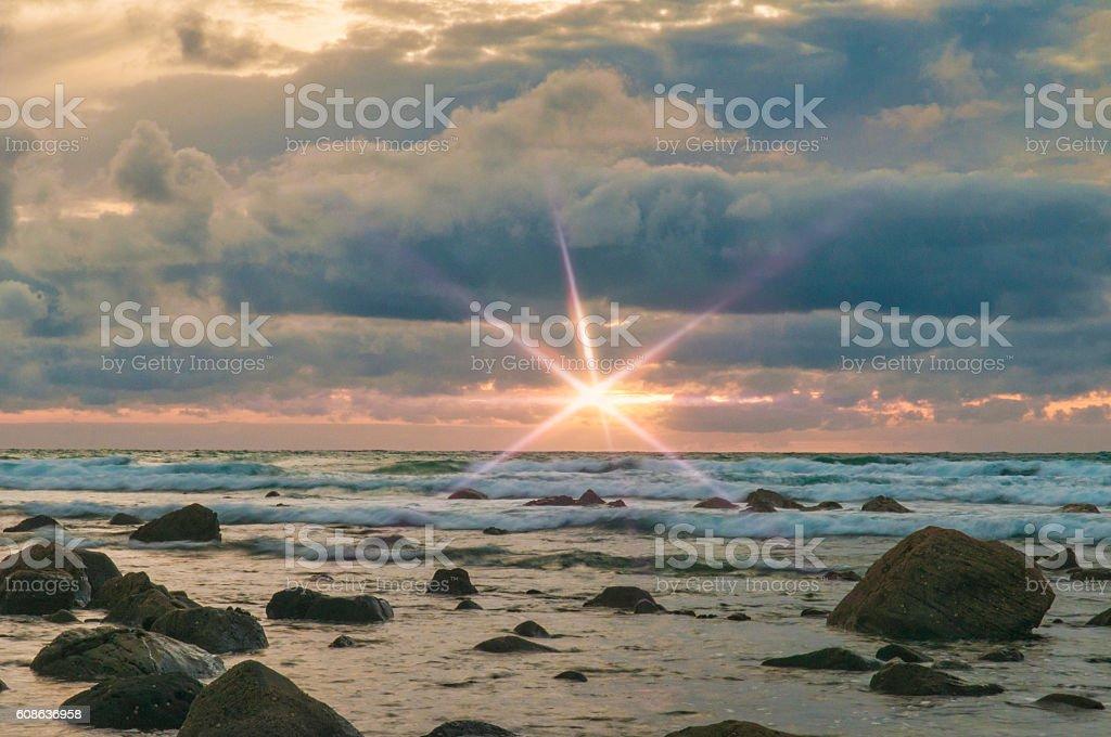 Taranaki Sunset with flare stock photo