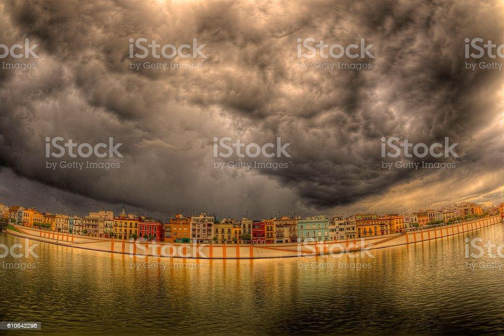 Tarde de tormenta en la Calle Betis, Sevilla color stock photo