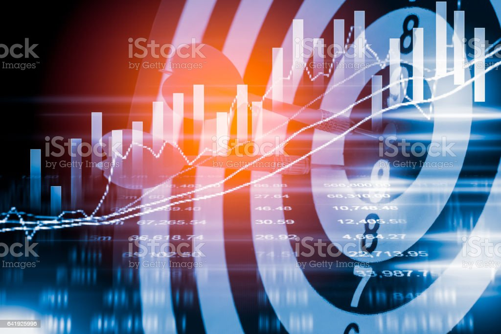 Target arrow on dart board and stock market indicator graph. stock photo