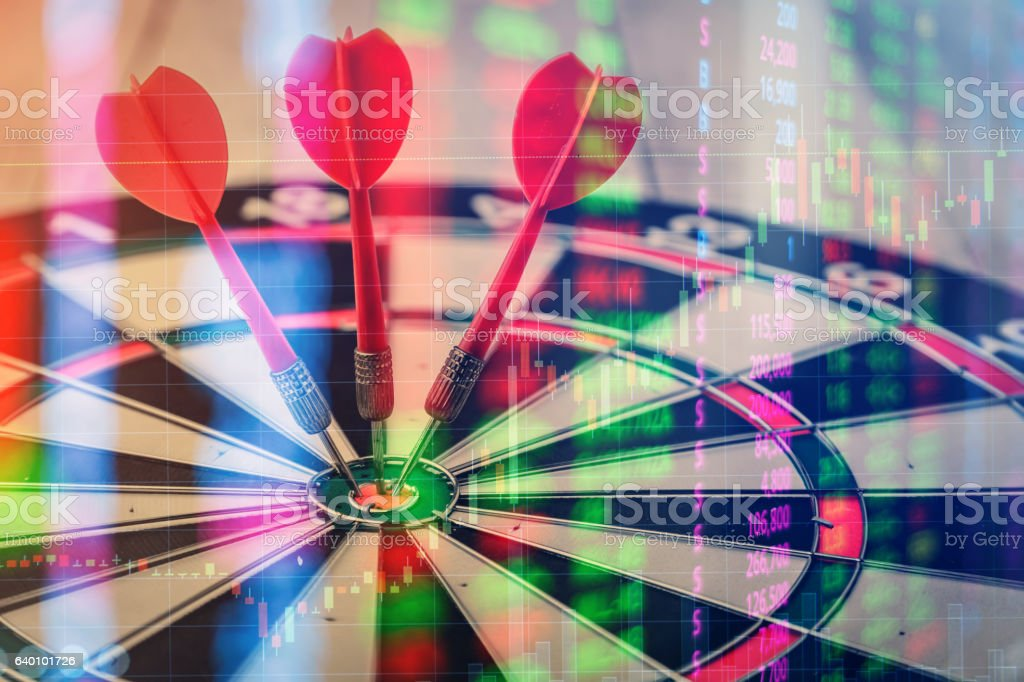 target dart with arrow over stock market chart stock photo