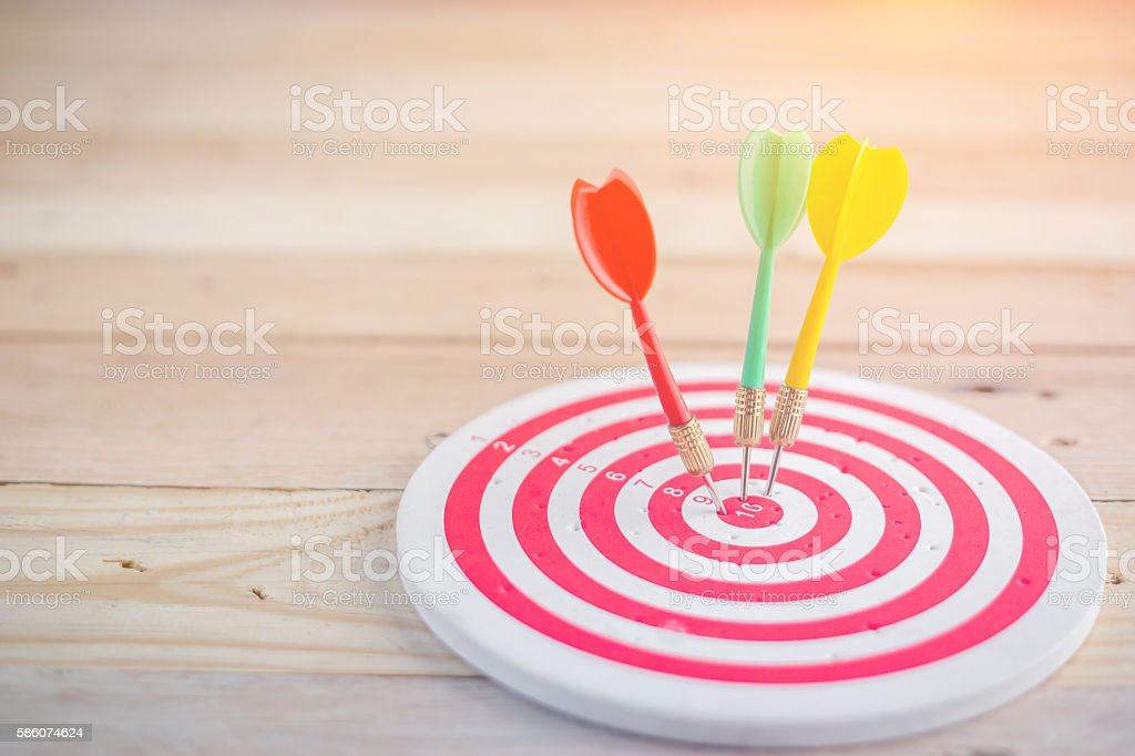 target dart with arrow over wooden background stock photo