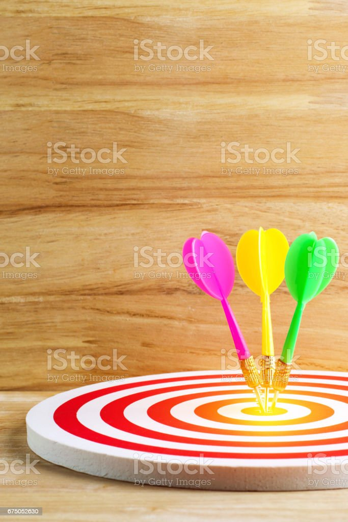 target dart with arrow over wooden stock photo