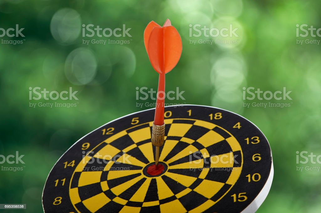 target dart with red arrow stock photo