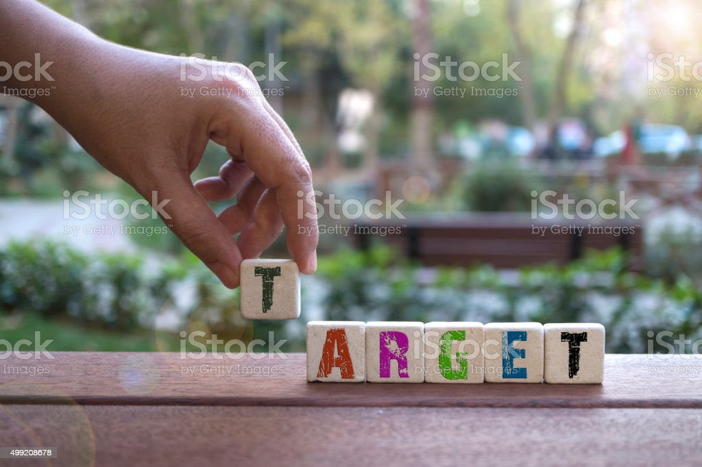 Target , Hand and Word with Alphabet Blocks stock photo