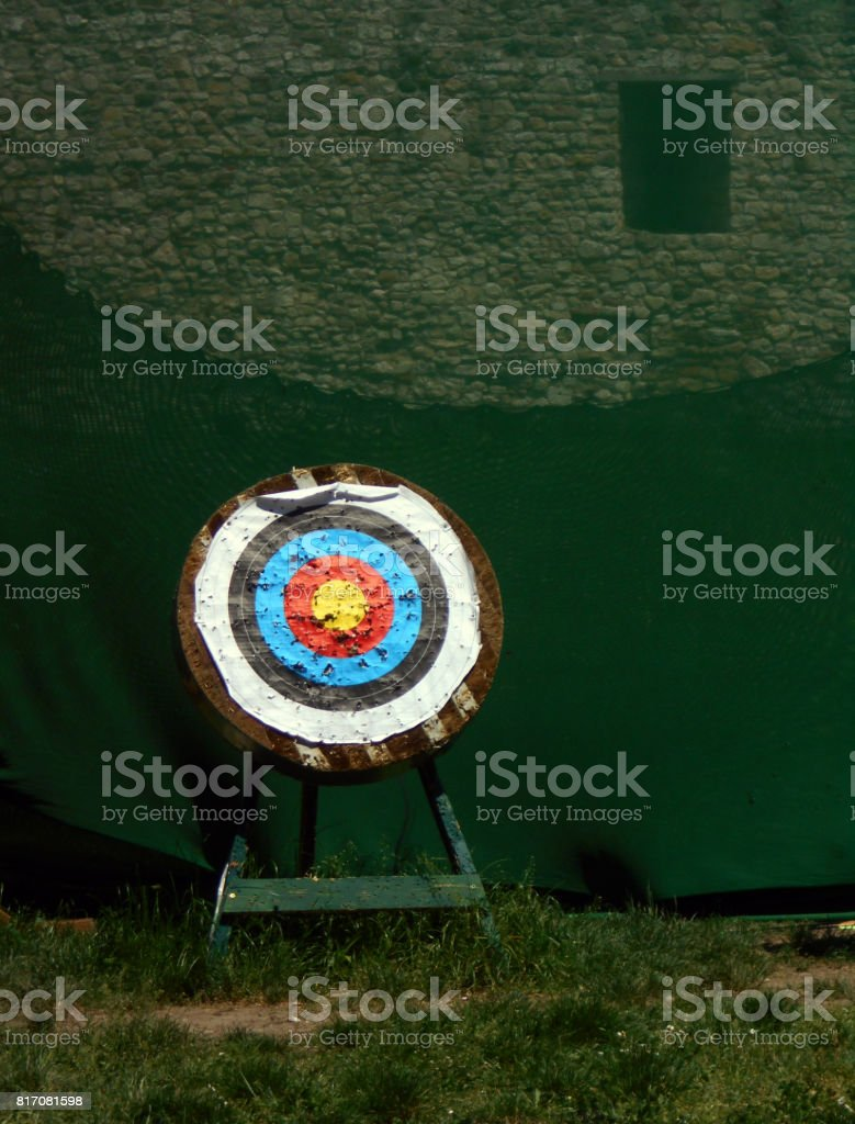 A target in front of a green protective net stock photo