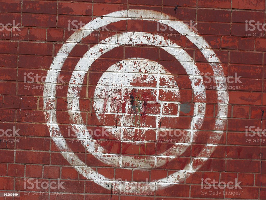 Target on the red brick wall. Urban style. royalty-free stock photo