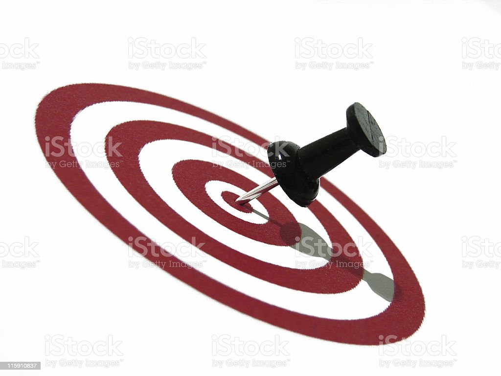 A target with a push pin in the center royalty-free stock photo