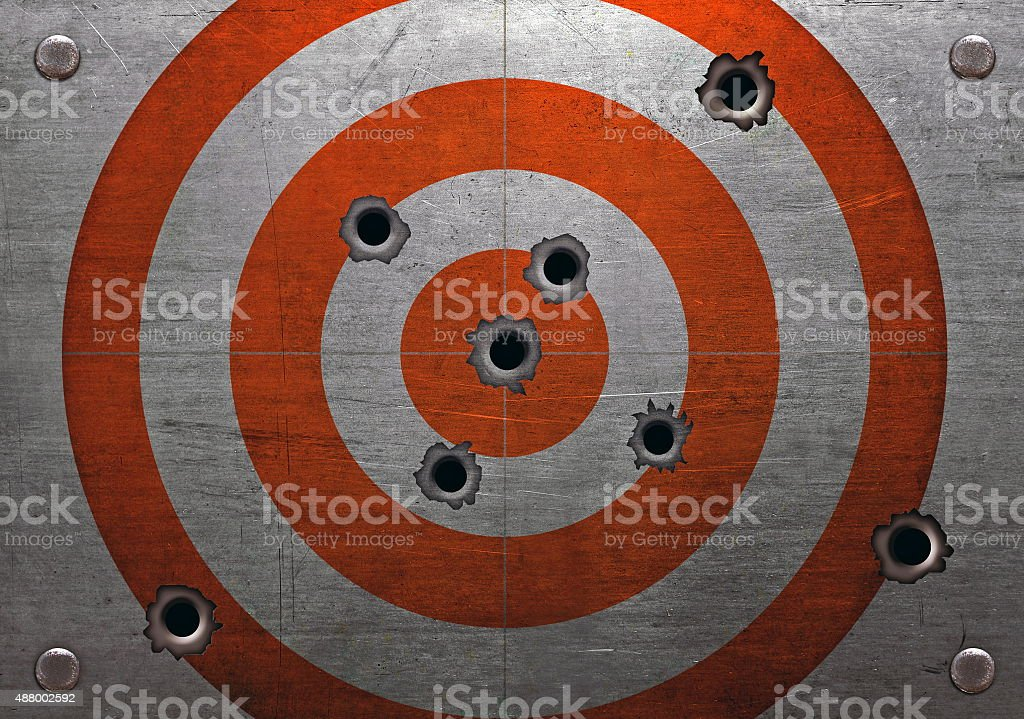 Target with bullet holes stock photo