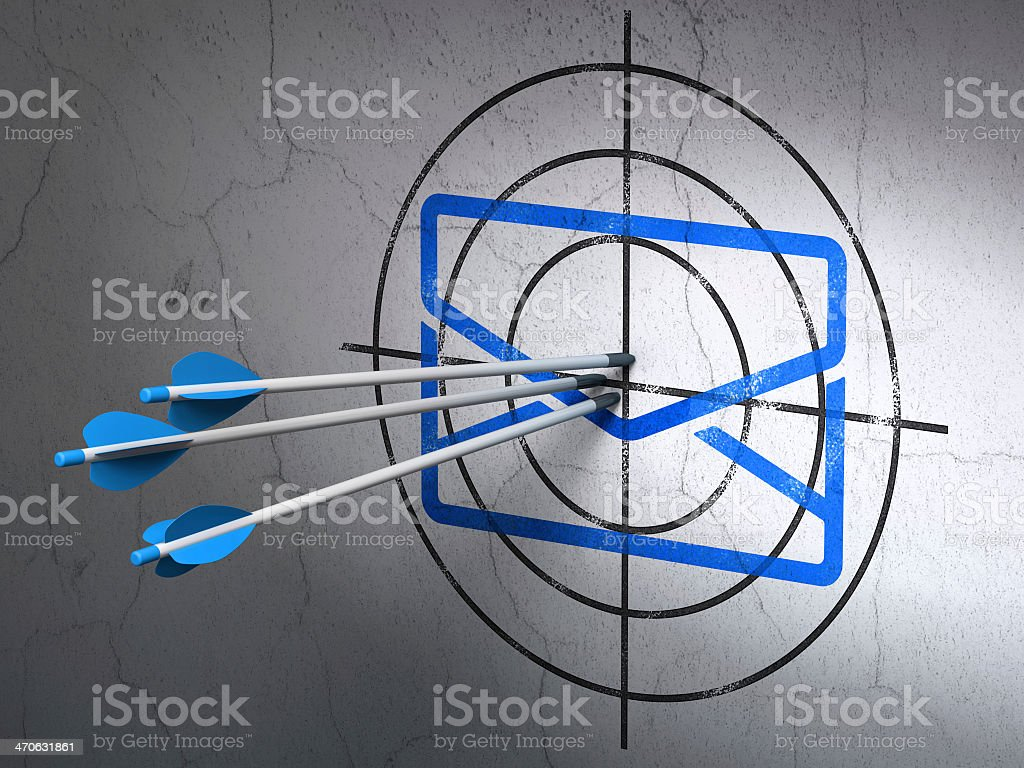 A target with three blue arrows thrown and stuck on it stock photo